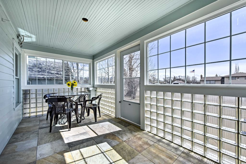 Enjoy warm mornings in the sun on the enclosed porch.