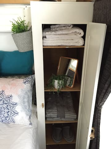 Storage on each side of the bed. Shelves or a cloth hanger can be adapted.