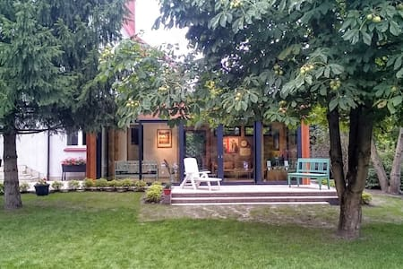 Home with garden & sunroom. Forest and lake nearby - Olsztyn