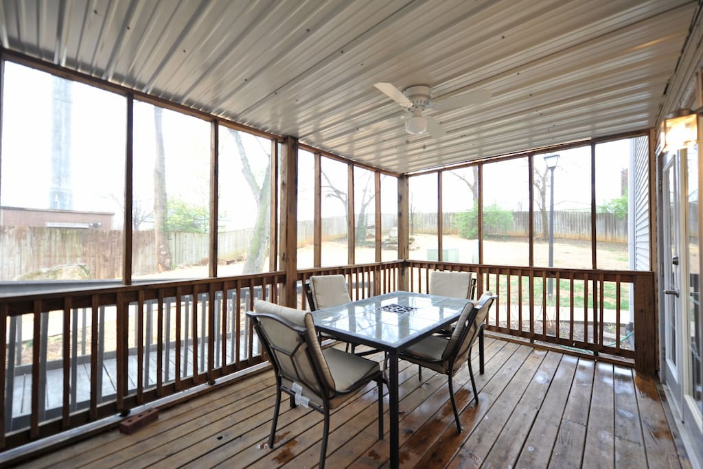 The screened-in porch, which is also a private entrance.