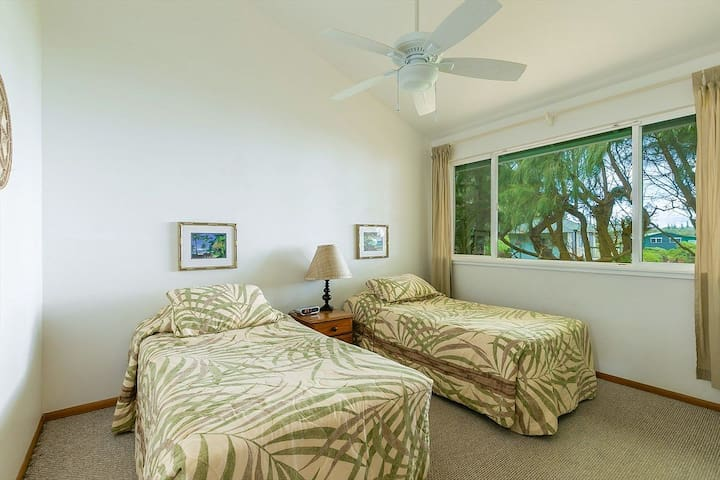 A spacious second bedroom also enjoys ocean views, vaulted ceilings, A/C  and a large closet.  Upon request with your reservation the twin beds can be replaced with a single King size bed.