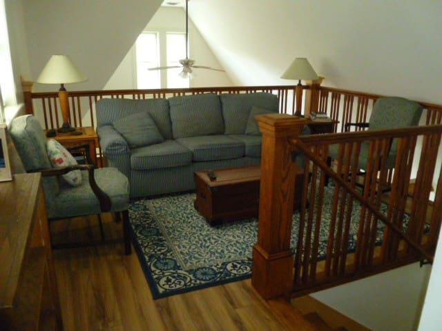 The loft has a sleeper sofa and serves also as TV area.