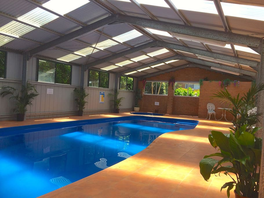 Shared Under covered heated Pool and Spa