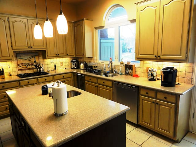 The kitchen is stocked with all the basics and features a full sink, prep sink and gas stove.