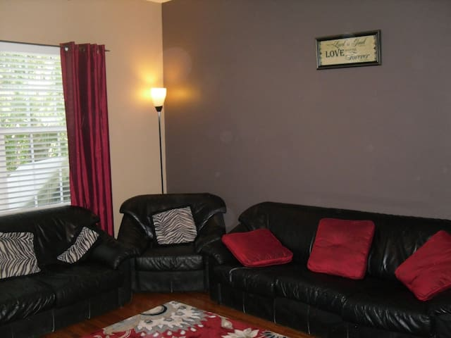 Full size couch, loveseat, and chair with black out curtains.