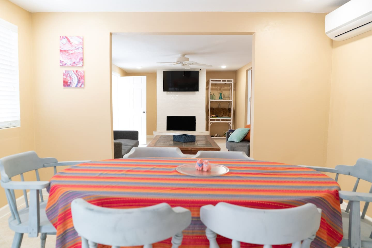 Dining area to living room - we update table cloths out - you may have a different color than shown