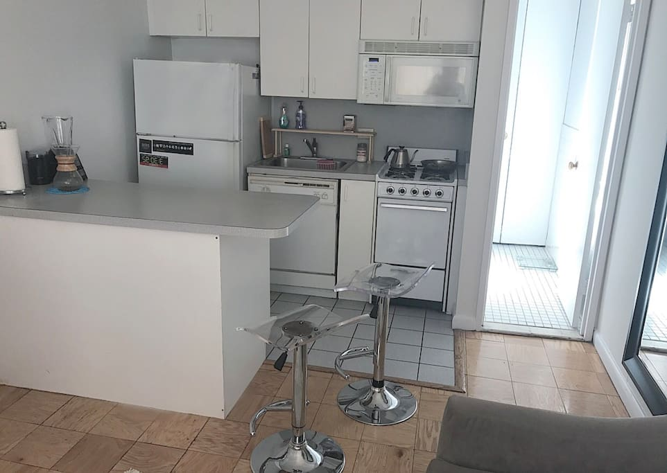 Middle of apartment facing kitchen and bathroom.