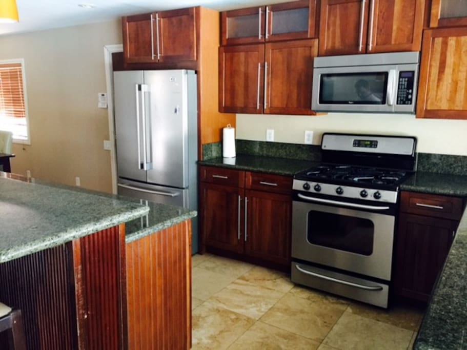 New kitchen with granite countertops and stainless appliances and dishwasher
