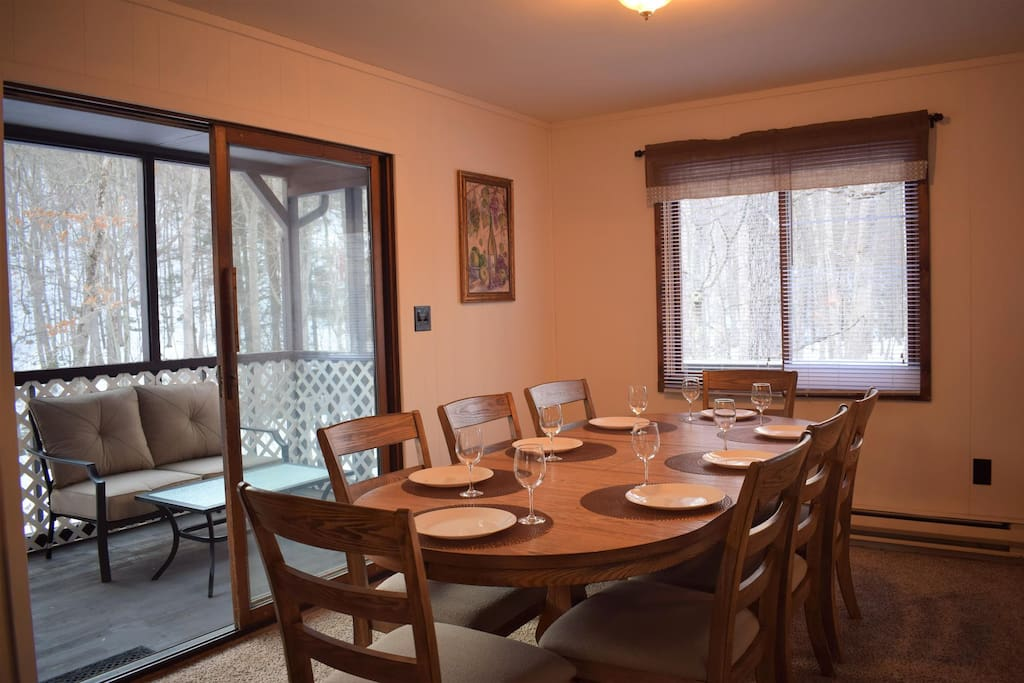 Upper Level Open concept dining room with view and access to enclosed deck and scenic nature
