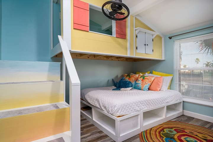 """Unique guest bedroom with Queen size bed below and a twin bed in the """"beach house"""" above."""