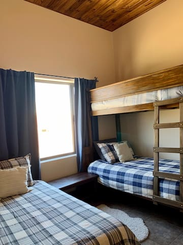 Comfortable bunk bed room that kids or adults will enjoy!