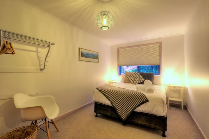 The spacious main bedroom is beautifully appointed and has a comfortable queen bed.