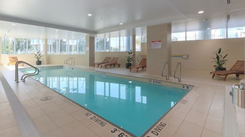 Indoor pool & hot tub connected to the gym. Level P4.