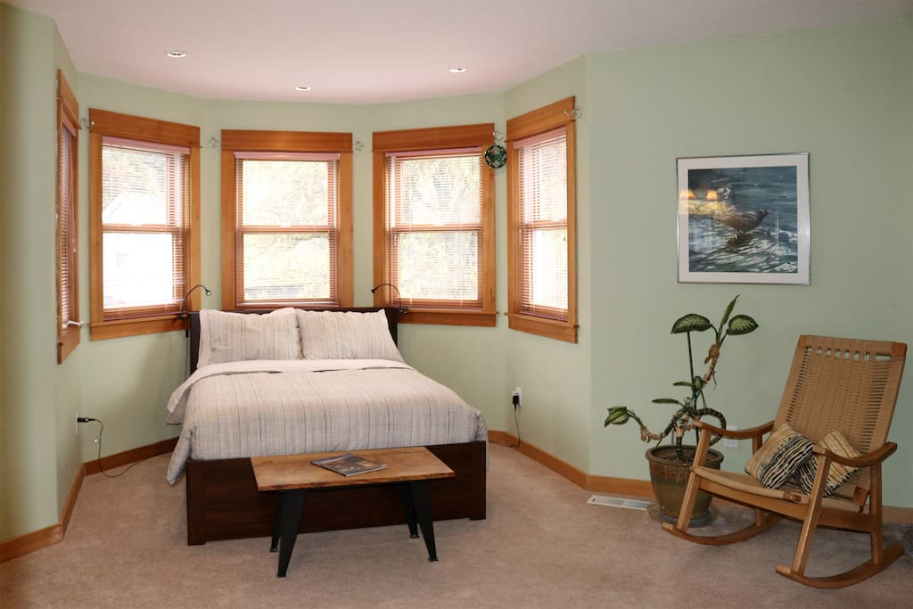 Second floor bedroom has a double bed, mini-fridge, pedestal sink and desk.  Lots of light.  Bathroom and other bedroom in this listing are adjacent.