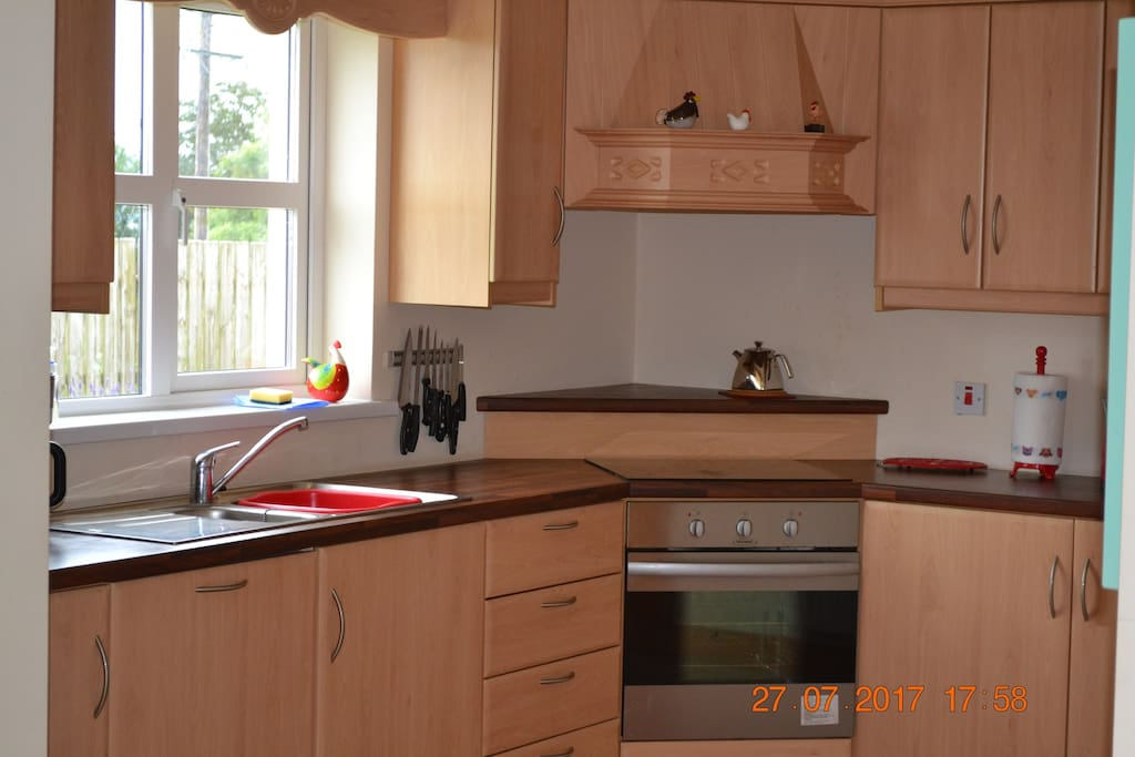 Fully fitted kitchen with fridge/freezer, induction hob, oven, microwave, washing machine and dishwasher