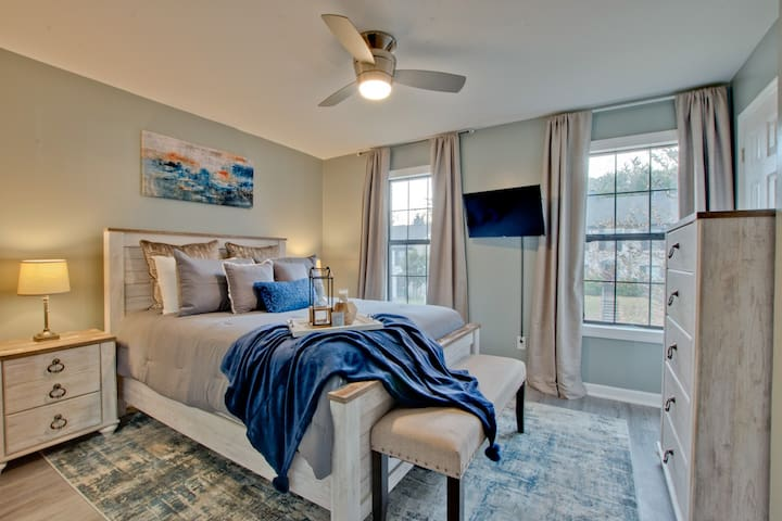 View of Bedroom one... nice and cozy, soft bedding with pillow top mattresses! Perfect for a good night's rest!