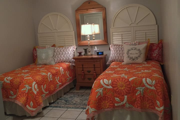 Second bedroom has two twin beds with custom-made headboards and decorator bedding.  Pieces that reflect our travel to Paris are used in this room. Bed rails for younger children are available upon request