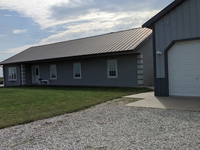 Flat parking & sidewalks to the front door. Three-bay garage available for vehicles or kenneled hunting dogs for a small additional fee. Main road is paved; driveway and outdoor parking is well-maintained gravel & cleared of snow in wintertime.