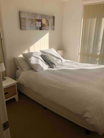 Second sunny bedroom with queen size bed