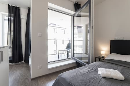 Enjoy your double room with the balcony in the quiet area of Libeň, still easily accessible to the historic city center.