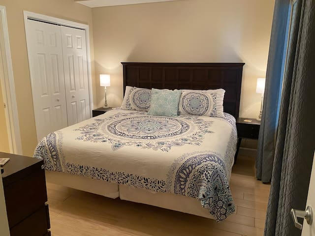 King bed in the master and nightstands with built-in charging stations