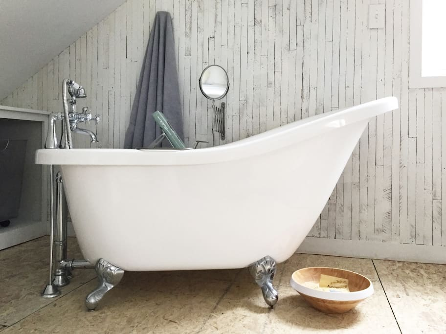 Relax in a clawfoot tub in your bedroom suite. @ripplebnb