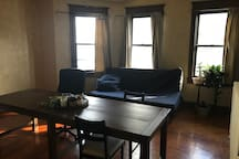 Dining room with large kitchen table.