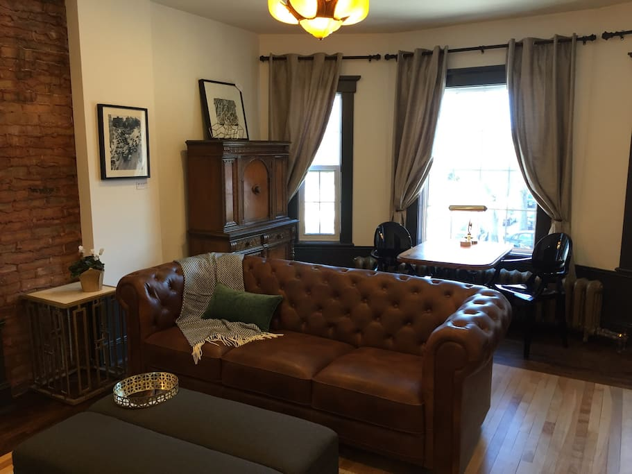 Living room adorned with antiques and local art