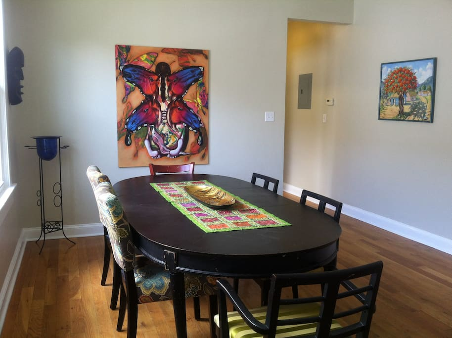 This table is in the dining room can be where you, your friends & family, can share meals together in this beautiful home which is steps away from Jazz Fest and only 2.4 miles from the French Quarter, Central Business District and Super Dome.