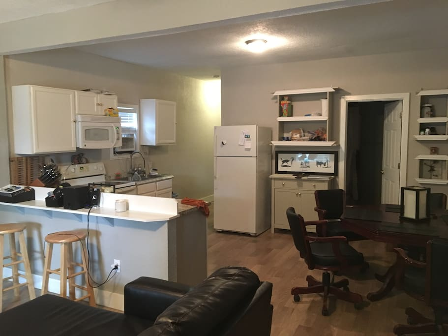 open kitchen area with seating for 4-6 with stools