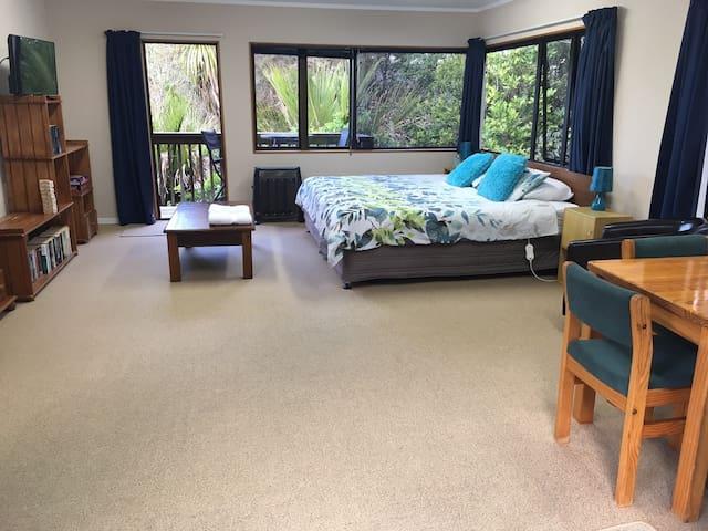 Huge main bedroom with deck opening onto bush