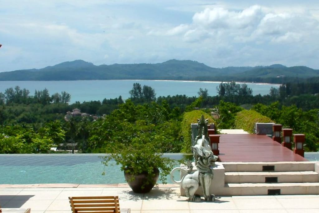 Stunning view of Bangtao beach and bay from the pool terrace.