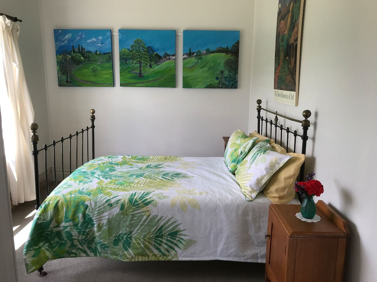 Our double room looks north onto the Waipu Caves Reserve. It features original artwork
