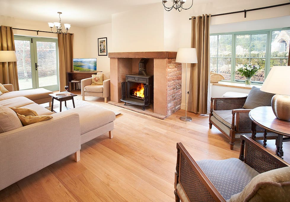 The Lounge with it's wood burning stove and French doors to the rear garden.