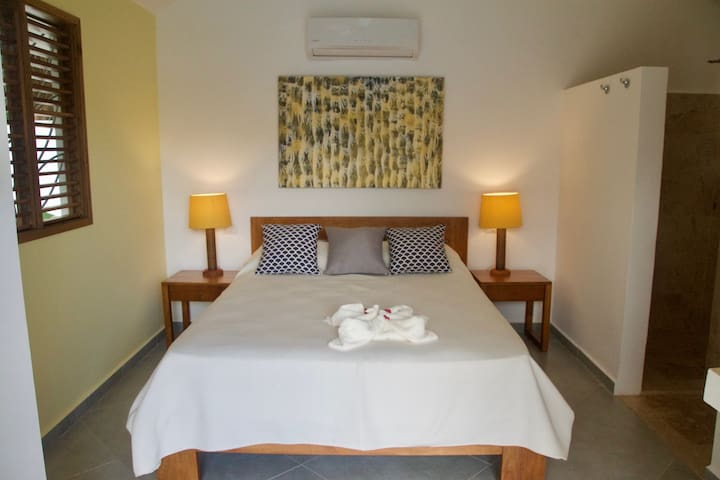 Bungalow is tastefully decorated, has a queen bed and its own terrace.
