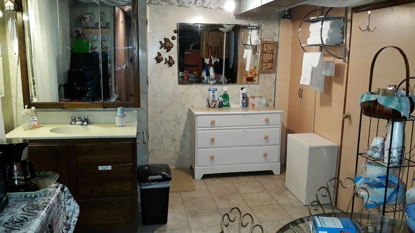 Side room includes a shower and sink; dresser; clothes hamper; table and chairs; microwave; refrigerator; coffee maker and much more.