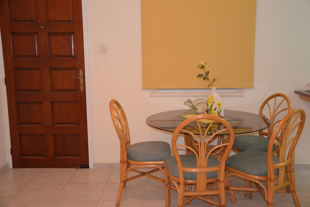 The living room has a large dining table