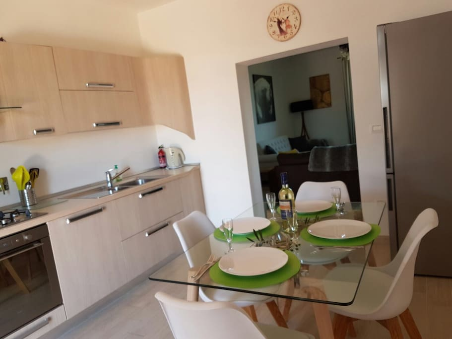 Guests enter the Apartment through a large modern open plan kitchen diner.