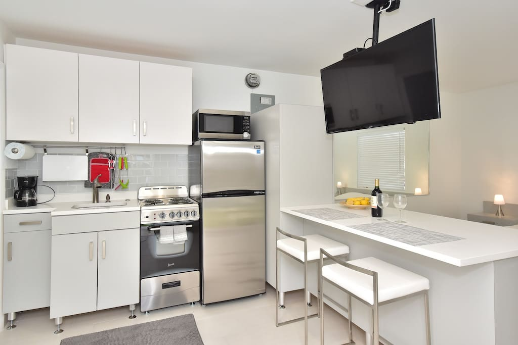 Fully equipped kitchen with stainless steel appliances & flat screen tv