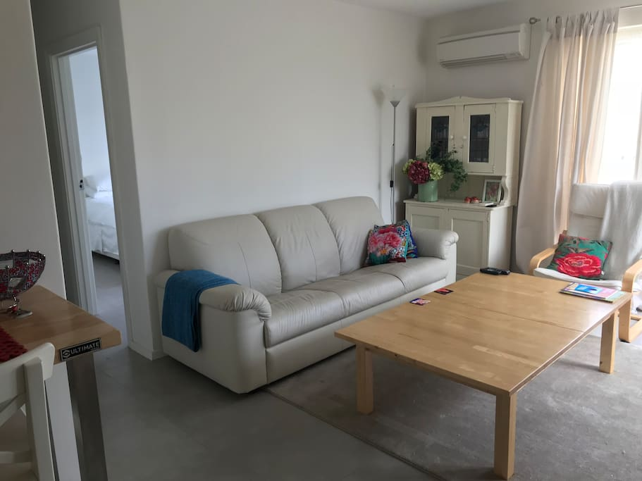 Large Lounge couch and table allows for lots of relaxing and games