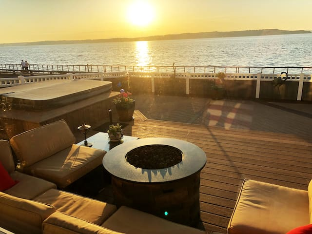 Elevated Deck with spa, fire pit and view of the Puget Sound and Boardwalk.