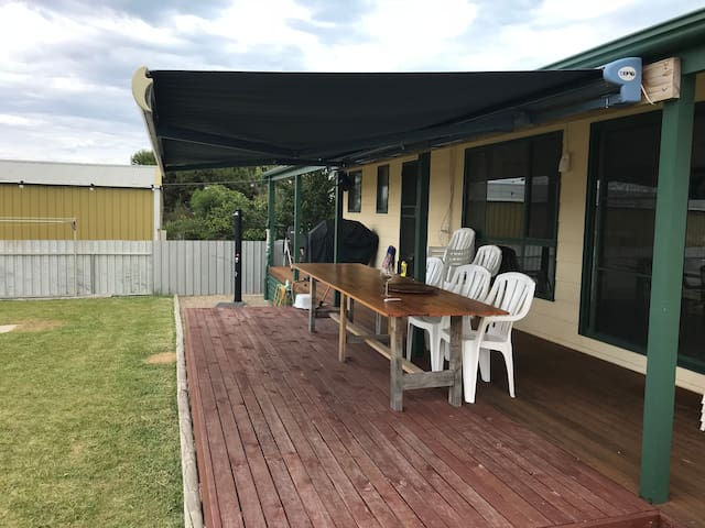 10 Seater Table with remote controlled awning and 4 Burner BBQ and outdoor shower
