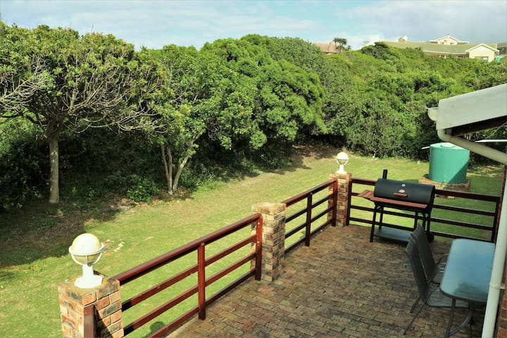 Secure, spacious and sheltered back garden with patio and braai.