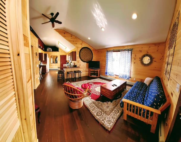 Comfortable living room overlooking the property. Full kitchen, bath, and laundry too.