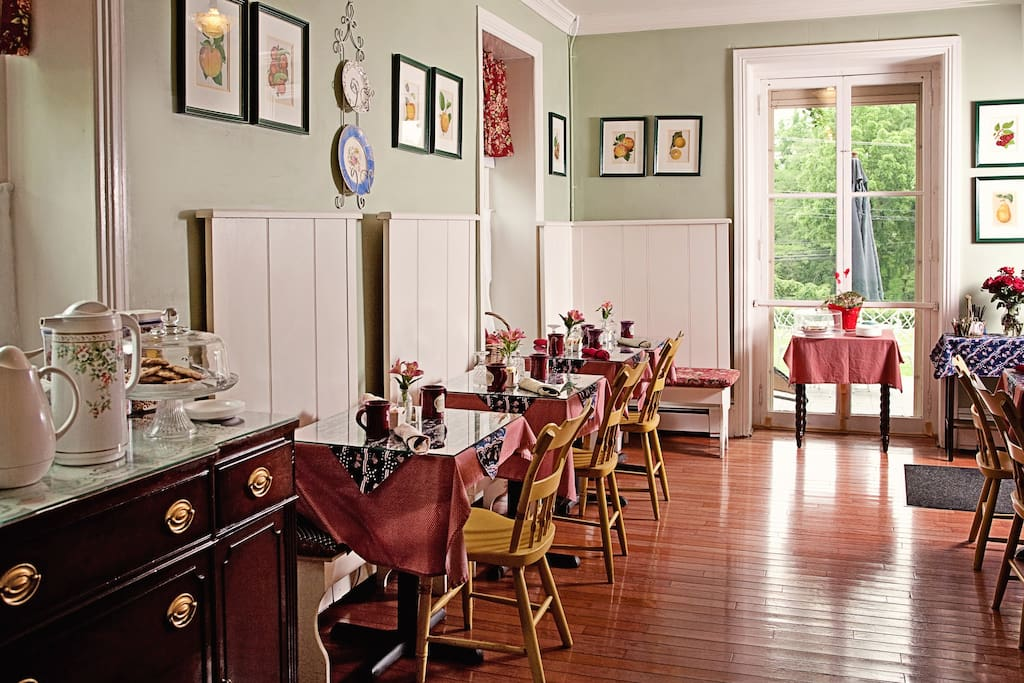 Sun light filled breakfast room where you are served hot breakfast.