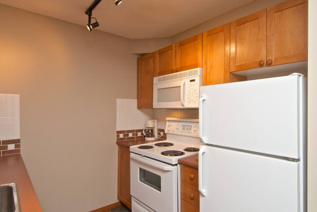 Kitchen with Dishwasher/ Fridge/stove and microwave