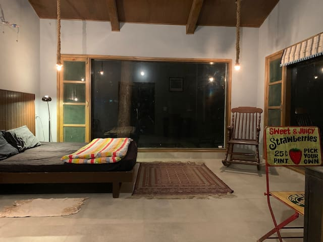 Spacious bedroom 2 with terrace and windows on both sides. Opens into spacious dressing room and bathroom