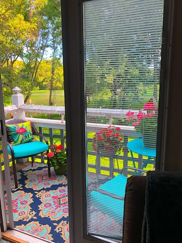 Summer at the spa!  Step out onto the beautiful balcony located right off the living room!   From there, you will have views of the golf course.