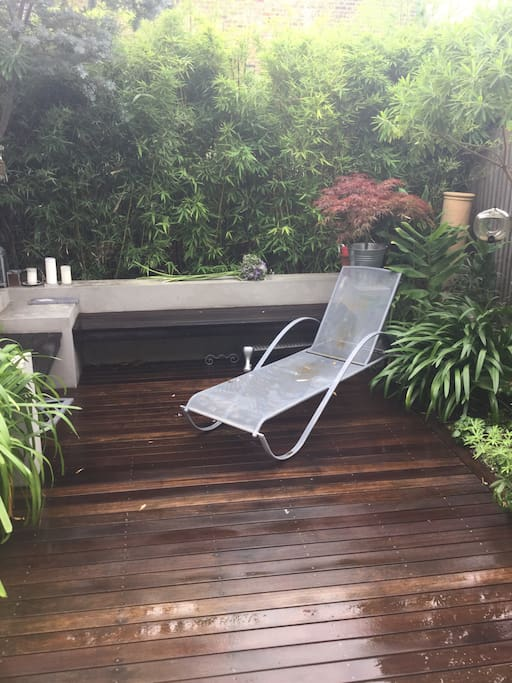Secluded garden with a variety of plants, an umbrella when needed & a BBQ upon request.