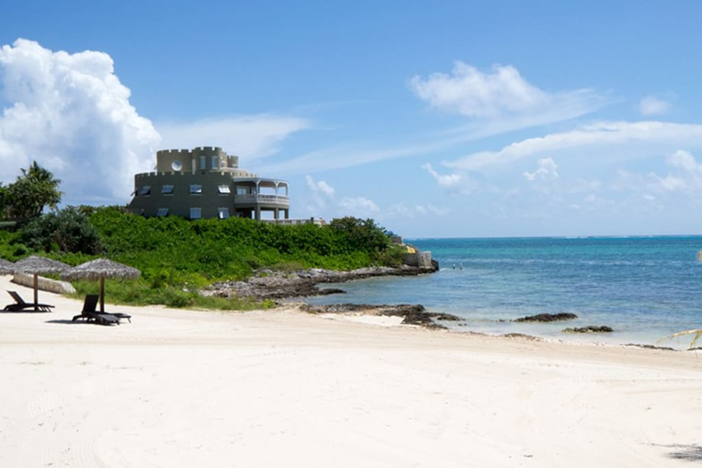 White sandy beach next to the Cayman Castle